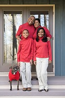 Portrait of a family in red sweaters