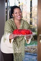 Smiling woman holing jello on a plate