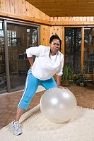 Woman in pain exercising