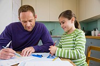 Father helping his daughter with homework (thumbnail)