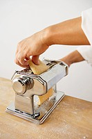 Making Pasta: Putting a Piece of Dough into a Pasta Maker