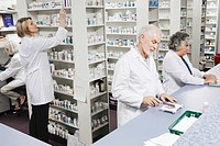 Pharmacists filling prescriptions