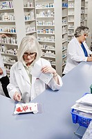 Pharmacists filling prescriptions (thumbnail)