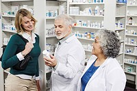 Pharmacists explaining medication to customer