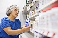 Woman looking at medical product on shelf