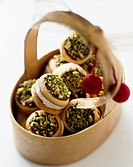 Cream Filled Sandwich Cookies Topped with Pistachios in a Basket