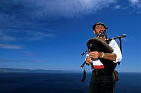 Piper playing a Bagpiper in Cape Finisterre, Costa de la Muerte, Galicia, Spain