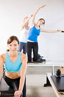Portrait of smiling Native American woman working out on pilates equipment