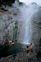 Relaxing in volcanic hot water waterfall, Kamuiwakka_no_taki falls, Shiretoko National Park, Hokkaido, Japan, Asia