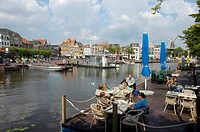 Guests sitting in a restaurant at a canal, Leiden, South Holland, Holland, The Netherlands
