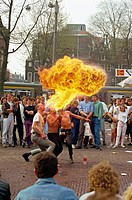 Fire breathers performing on Leidseplein, Amsterdam, Holland, Europe
