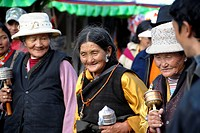 Old Tibetan pilgrims with prayer wheels Lhasa Tibet China