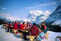 People take a break from skiing in mountain top bar, Wengen, Bernese Oberland, Switzerland, Europe