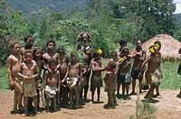 Portrait of a Huli man and group of children Highlands, Papua New Guinea, Pacific