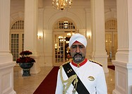 Doorman in front of the entrance of the Raffles Hotel, Singapore