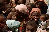 Smiling girl in crowd of children, near Zinder, Niger, West Africa, Africa
