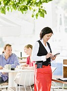 Female waitress taking orders