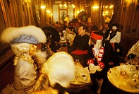 Venetian masks in the Cafe Florian Carnival in Venice Italy