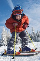 Six year old boy on skis Winkelmoosalm Upper Bavaria Germany Salzburger Land Austria