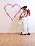 Man holds pregnant girl.
