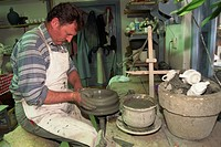 Man working on potter´s wheel, ceramics workshop, Corund, Transylvania, Romania, Europe