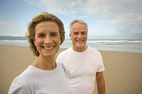 Portrait of couple smiling on a beach