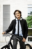 Man on a bicycle, headphones on