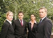 A portrait of a business group.
