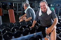 Portrait of senior man working out at gym, looking at camera