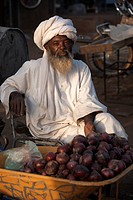 A local trader selling onions at Atbara Souq, Sudan, Africa