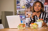 Portrait of African woman having working lunch in meeting
