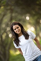 Portrait of young woman standing in t_shirt