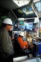 Two men in control room of drilling platform