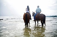 Hawaii, Kauai, Gillin´s Beach, Beautiful girl and her father riding a horse.