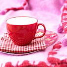 red cup on chequered napkin