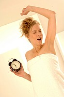 Woman with alarmclock