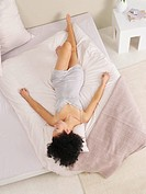young woman streched out on the bed