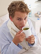 young man having a cup of herb tea