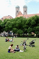 people resting in public park at Marienplatz Munich, Bavaria, Germany