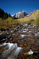 Maroon Bells and Maroon Creek with fall colors, Colorado, United States of America, North America