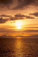 Sunset over the Minch, from Trotternish, Harris in the distance, Isle of Skye, Inner Hebrides, Scotland, United Kingdom, Europe