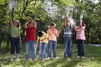 Children standing on lawn