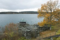 Lake scene with stone wall and boathouse
