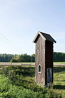 Wooden tower in field