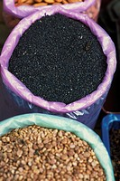 Nigella seeds and lentils in buckets, high angle view