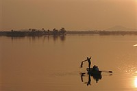 Sunset over lake created by dam, Deogarh, Rajasthan, India
