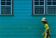Woman walking in Anse La Raye, St. Lucia, Windward Islands, West Indies, Caribbean, Central America