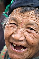 Happy, senior, Hani minority woman at Shalatou market, Yuanyang, Yunnan, China No model release available