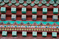 Architectural detail of Tibetan Buddhist themes under eaves of building in temple compound, Erdene Zuu monastery, north central Mongolia