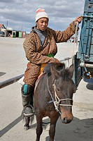 Mongolian horseman wears beautiful coat, north-central Mongolia No releases available